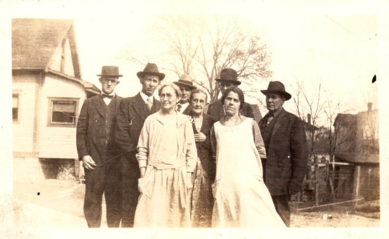 Photo of group outside house early 20th century
