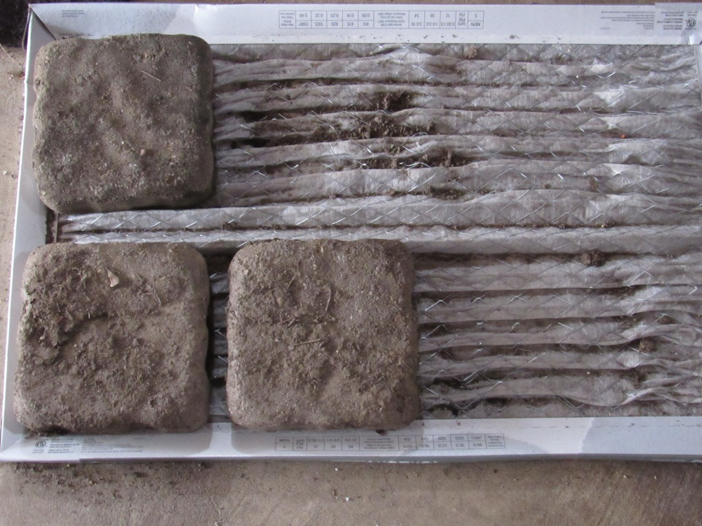 Photo of cobblestones placed on furnace filter